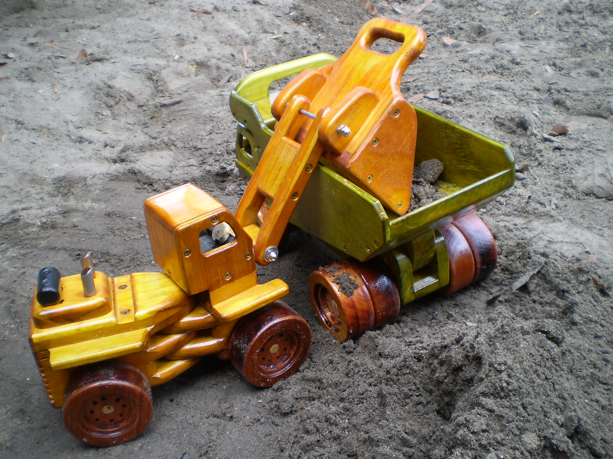 Wooden front end loader loading dump truck